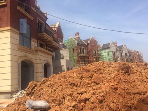 武汉恒大旅游科技城刮砂漆工程项目
